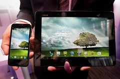 Asus's product, the PadFone 2, lets the user slide a cellphone into the back, turning a tablet into an oversize cellphone.