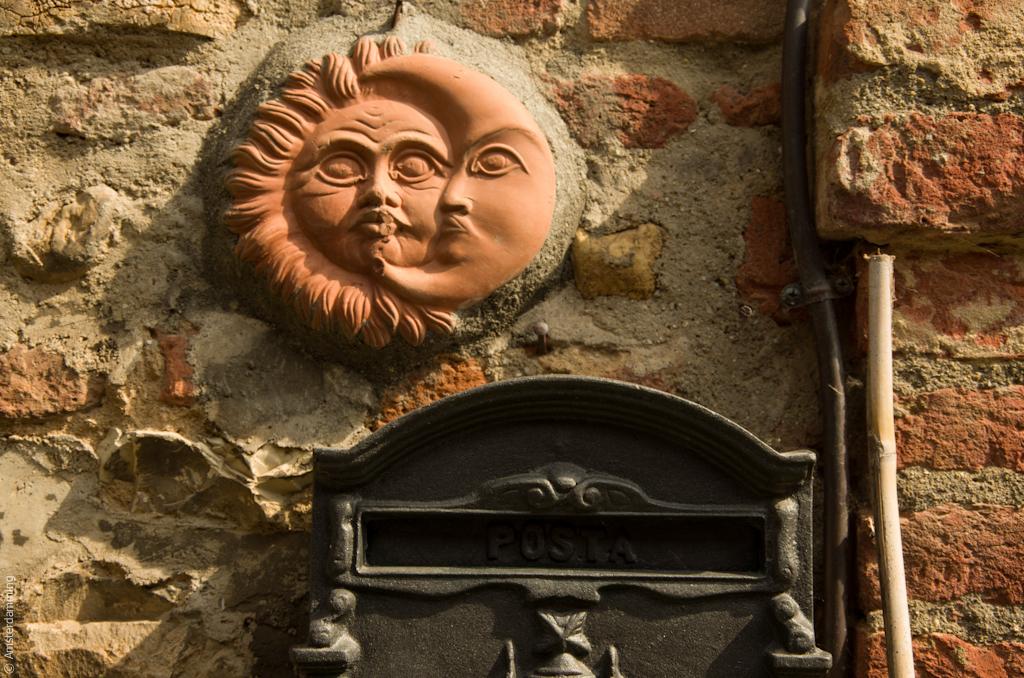Italy, Terracotta Sun & Moon in Città della Pieve