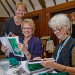 hmc036 -- Barb Brown Robertson '63, Carol Phillips Walicki '63 and Liz Coulter Curl '67 look at the class reunion booklet at the 50-year reunion celebration.