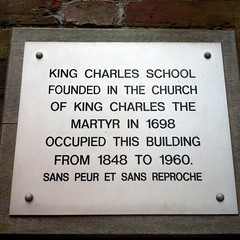 Photo of King Charles School white plaque