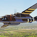 """A vintage B-25 Mitchell """"Axis Nightmare"""" flies by the National Museum of the U.S. Air Force at Wright-Patterson Air Force Base, Ohio, April 18, 2010. The flight was in honor of the Doolittle Raiders attack on Tokyo April 18, 1942. (U.S. Air Force photo/Tech. Sgt. Jacob N. Bailey)"""