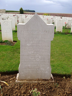 PUCHEVILLERS BRITISH CEMETERY and more recent image of the gravestone of Herbert Walter Crowle