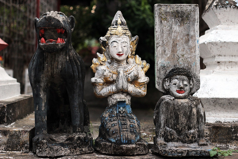 Praying figures at a Buddhist temple in Luang Prabang, Laos