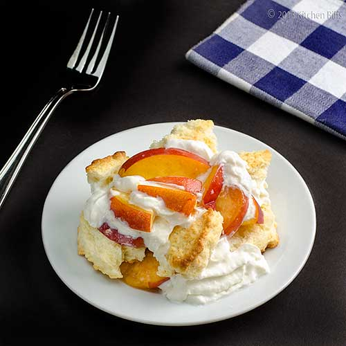 Peach Shortcake on plate with fork and napkin in background