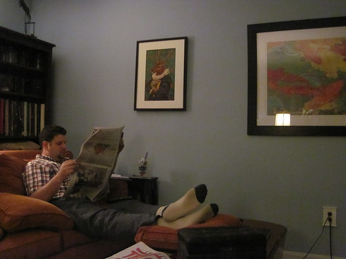Jason sitting on the couch with the Jeremiah Vanderkamp print on the wall overhead