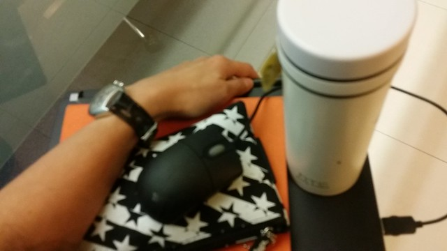 Laptop & mouse, notebook, pencil case and my water flask.