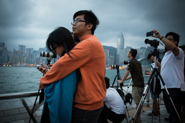 People watch the annular solar eclipse in Hong Kong