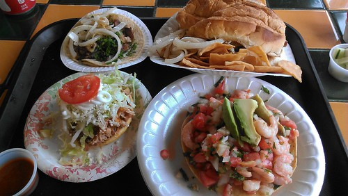 Suadero Taco, Chicken Taco, Carnitas Sope and Shrimp Tostada