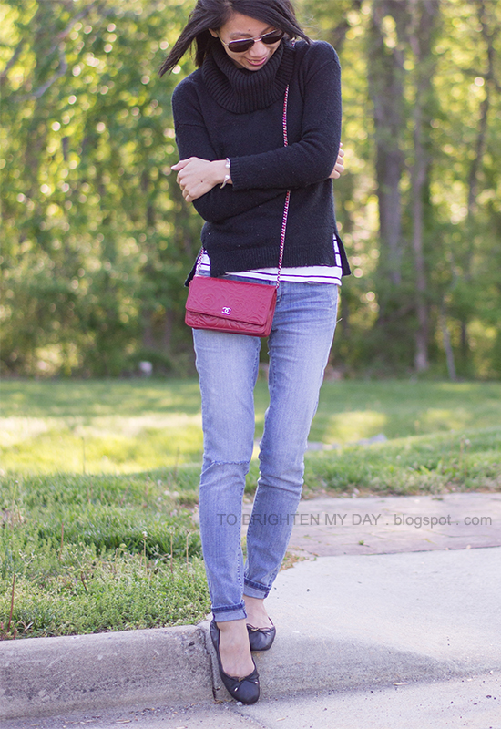 black cowlneck sweater, striped top, red crossbody bag