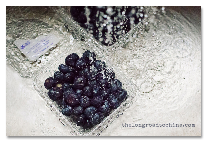 Blueberries in the Stainless Steel Sink with water splashing down BLOG