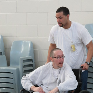 Sergio Hairston, standing (he's a hospice volunteer)with unnamed inmate