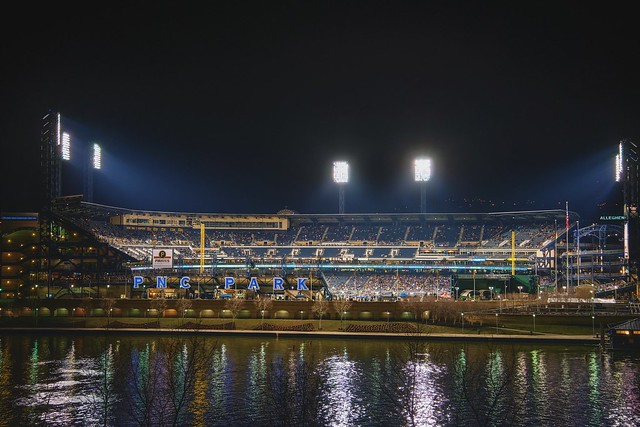 Lights shine in PNC Park at night from downtown Pittsburgh