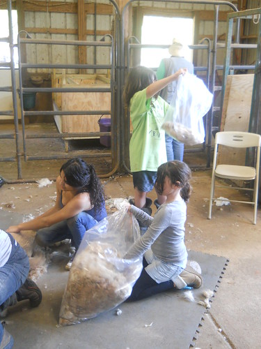The girls helped put the fleece in bags