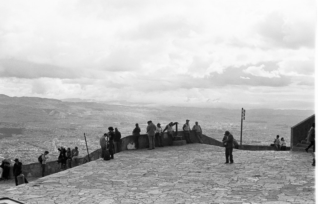 people along the wall in monserate colombia.jpg