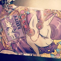 The best-ever booth partner in the world @chinochinako got me #Rarity goodies at #BronyFanFair! What a sweetie! I also got the same design of the wallet as a t-shirt... #obsessed