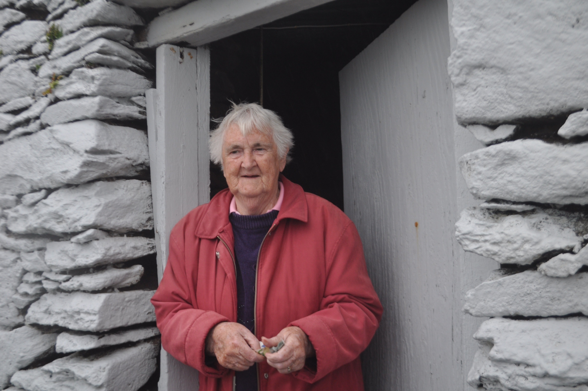 Mary, Keeper of the Fahan Beehive Huts, County Kerry, Ireland