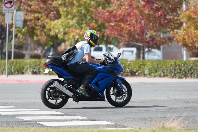 Man riding blue Kawasaki Ninja 250R in road - Identified ...