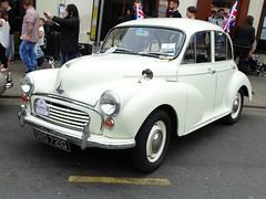 austin fx4(0.0), dkw 3=6(0.0), automobile(1.0), vehicle(1.0), mid-size car(1.0), morris minor(1.0), compact car(1.0), antique car(1.0), sedan(1.0), classic car(1.0), vintage car(1.0), land vehicle(1.0),