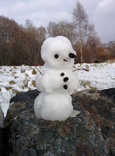 mini snowman (after a brief snowball fight)