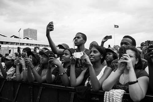 kids with phones at concert