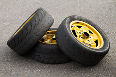 tire, automotive tire, automotive exterior, natural rubber, yellow, wheel, tread, rim, spoke,