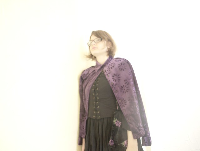 Purple cardigan, black bag with violet flowers