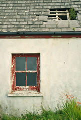 Valentia abandoned cottage with red window