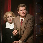 Pamela (Ferrin) and Hannay (Edwards) spot trouble from their opera box in the Huntington Theatre Company's pre-Broadway American premiere production of Alfred Hitchcock's