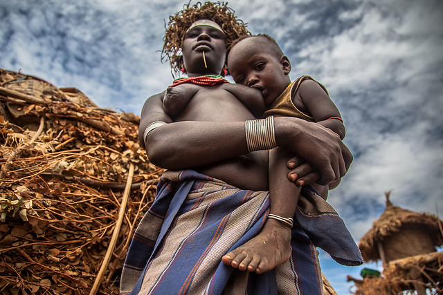 dassanech tribe,  mother with her ​​son in her arms, near omorate, lower valley of the omo, ethiopia