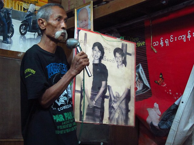 Lu Maw Showing Picture with Aung San Suu Kyi