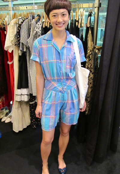 We love the cut of this turqouise checkered romper! The drop-waist hugs your curves perfectly. Size: S