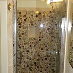Glass tile and travertine shower