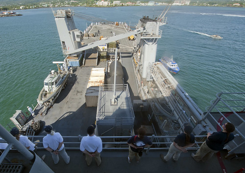 Pacific Partnership 2013 non-governmental organization volunteers main the rails of USS Pearl Harbor (lsd52)