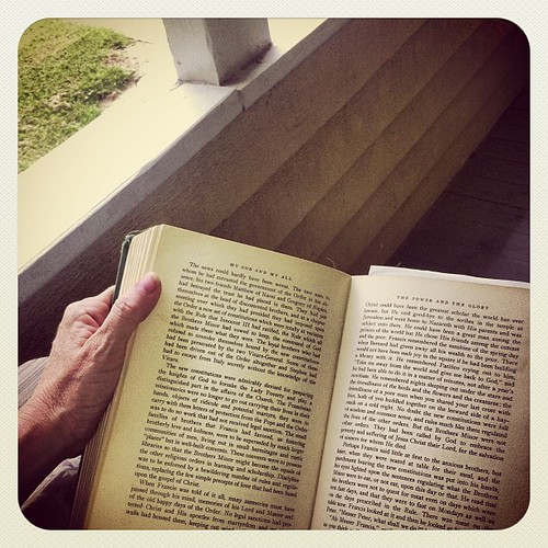 Reading about St. Francis of Assisi on my mom's porch swing.