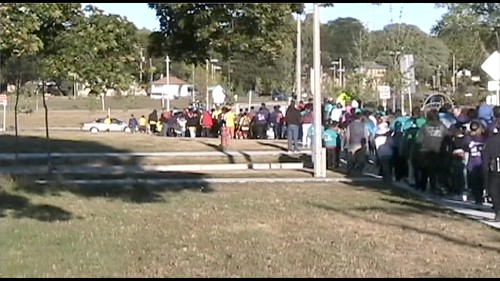 Eight different Neighborhoods come together and walk for a mile