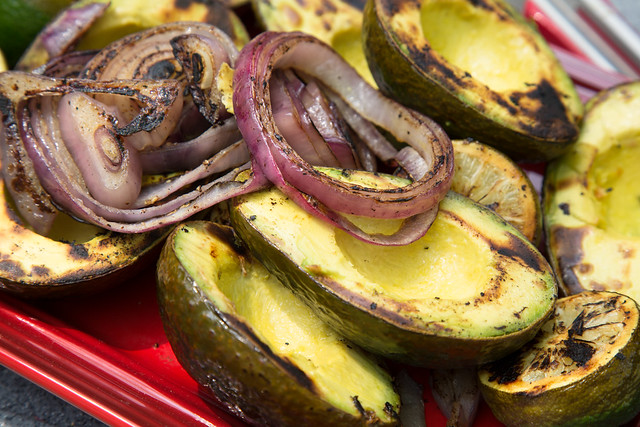 Grilled avocados, limes, onions