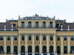 Schönbrunn Palace detail with clock, in Vienna Austria