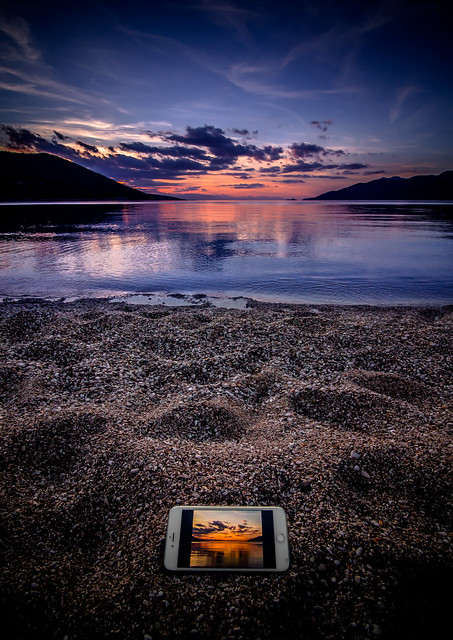 Mobile phone at sunset