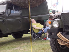 DAMYNS HALL MILITARY AND CAR SHOW IN A LONDON BOROUGH SUBURB STREET VENUE  ESSEX ENGLAND VERY HOT DAY AND THIS POOR LADY JUST FELL ASLEEP NEXT TO HER LAND ROVER. I GUESS SHE MISSED THE SHOW . . SLEEPING BEAUTY WAITING FOR HER PRINCE TO COME. 06-08-2016 DS