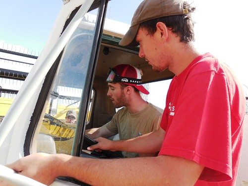 Brandon teaching Graham to drive the service truck