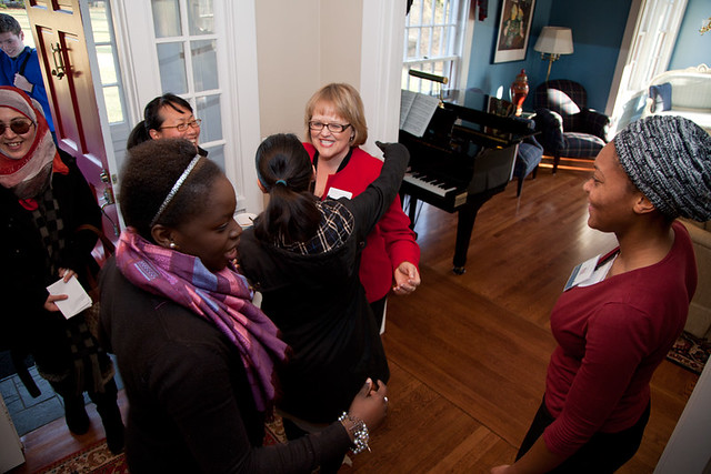 Lynn Baker Dooley greeting students at her home
