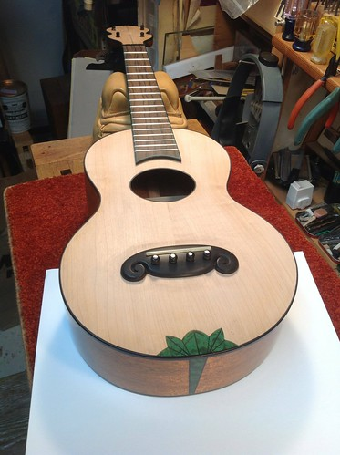 Tickler uke #3 progress showing green inlay and carved bridge by Amy Crehore
