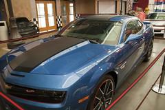 executive car(0.0), chevrolet(1.0), automobile(1.0), automotive exterior(1.0), wheel(1.0), vehicle(1.0), performance car(1.0), automotive design(1.0), rim(1.0), auto show(1.0), bumper(1.0), land vehicle(1.0), luxury vehicle(1.0), chevrolet camaro(1.0), muscle car(1.0), coupã©(1.0), motor vehicle(1.0),