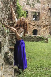 Betiana at ruin wall