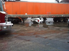 18wheeler picked up and dropped on compact car.