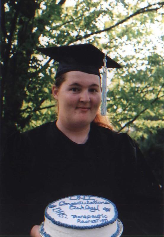 Ashley graduates with her cake