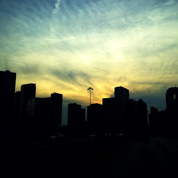 Sun setting on the Dallas skyline.