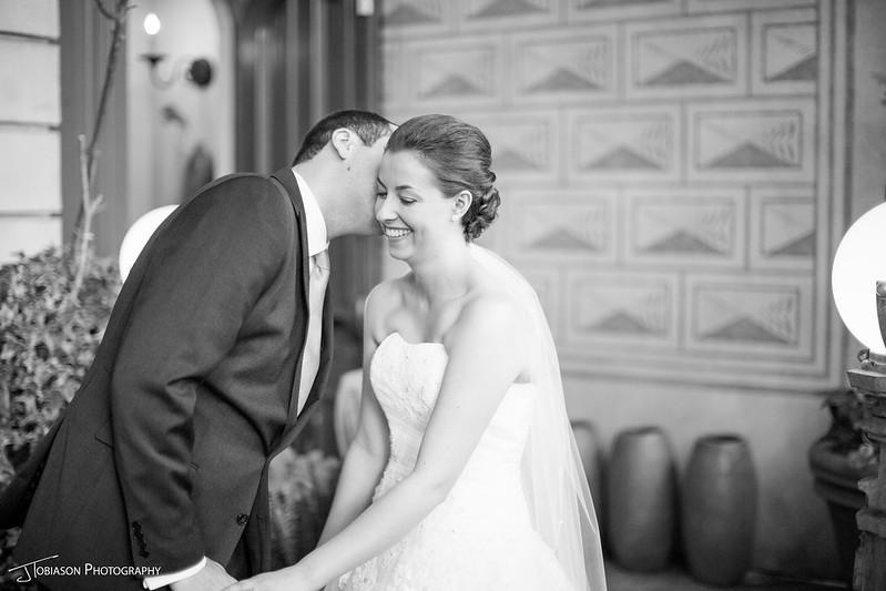 Groom kissing bride wedding day