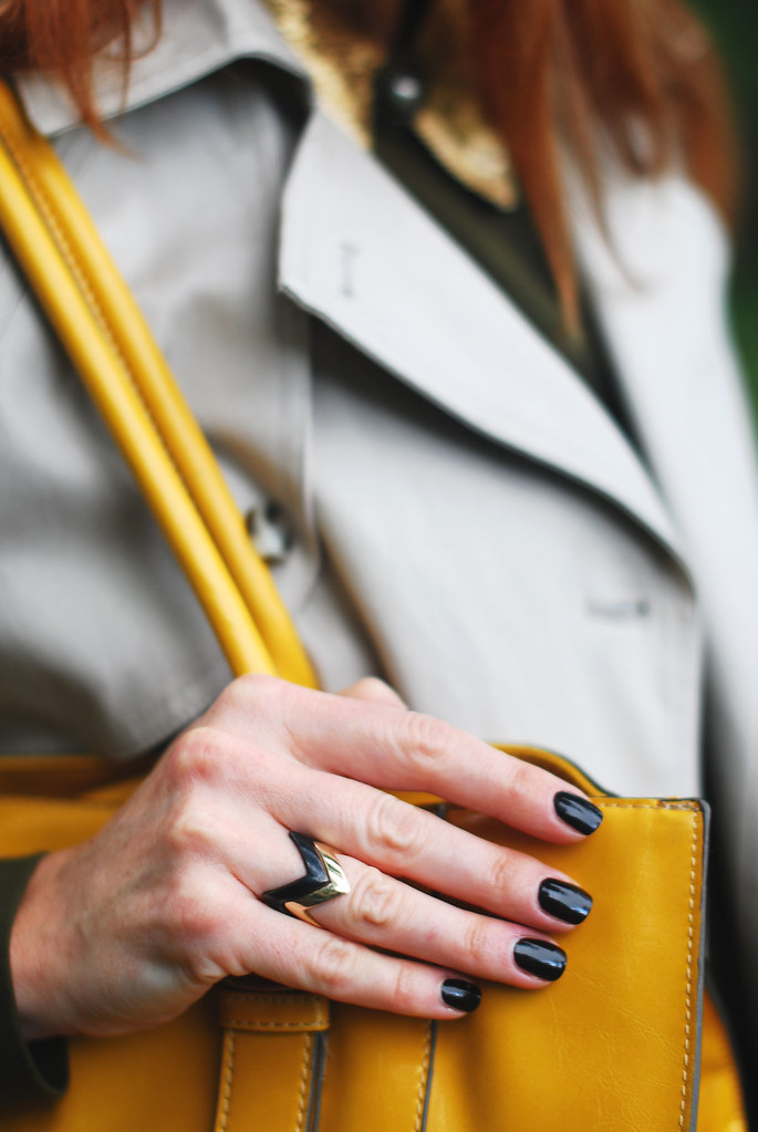Black manicure, yellow tote