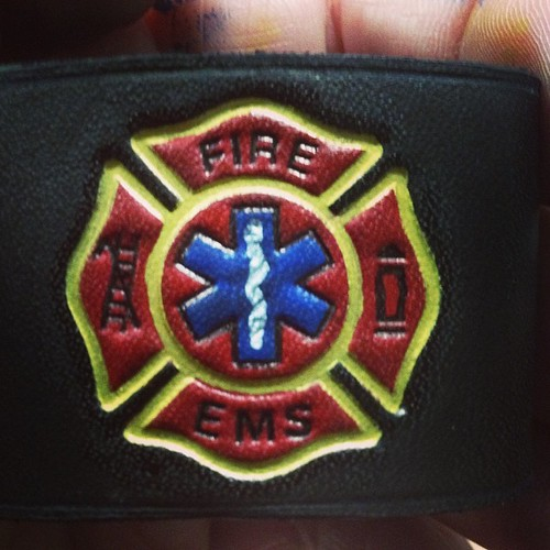 Fire/EMS Maltese on a radio strap belt loop.